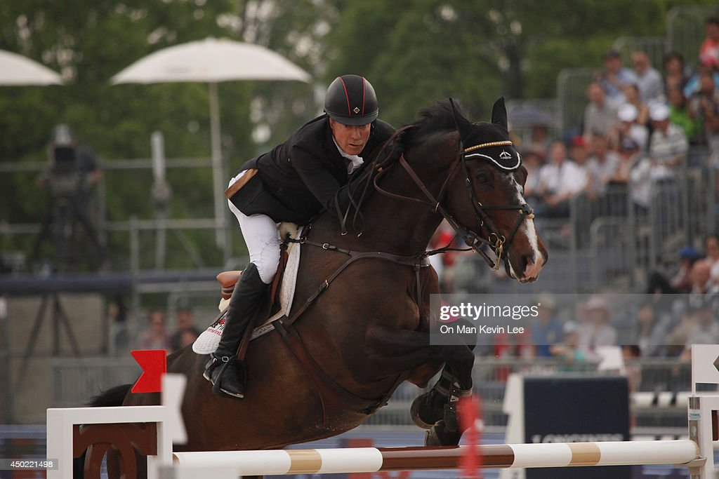 <a gi-track='captionPersonalityLinkClicked' href=/galleries/search?phrase=Michael+Whitaker&family=editorial&specificpeople=607520 ng-click='$event.stopPropagation()'>Michael Whitaker</a> of Great Britain rides Amai during Shanghai Longines Global Champions Tour on June 07, 2014 in Shanghai, China.