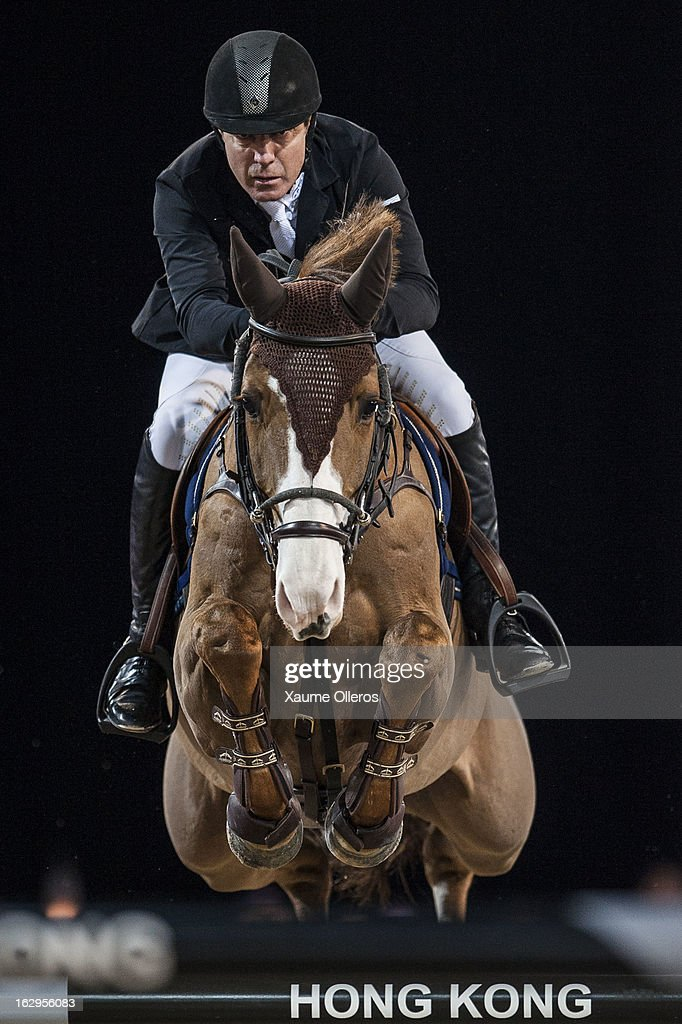 <a gi-track='captionPersonalityLinkClicked' href=/galleries/search?phrase=Michael+Whitaker&family=editorial&specificpeople=607520 ng-click='$event.stopPropagation()'>Michael Whitaker</a> of Great Britain rides Viking at the Longines Grand Prix during the Longines Hong Kong Masters International Show Jumping at Asia World Expo on March 2, 2013 in Hong Kong, Hong Kong.