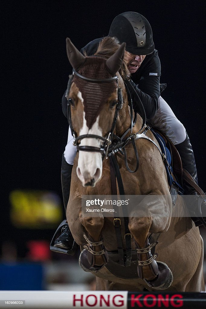 Michael Whitaker of Great Britain rides Viking at the Longines Grand Prix during the Longines Hong Kong Masters International Show Jumping at Asia World Expo on March 2, 2013 in Hong Kong, Hong Kong.