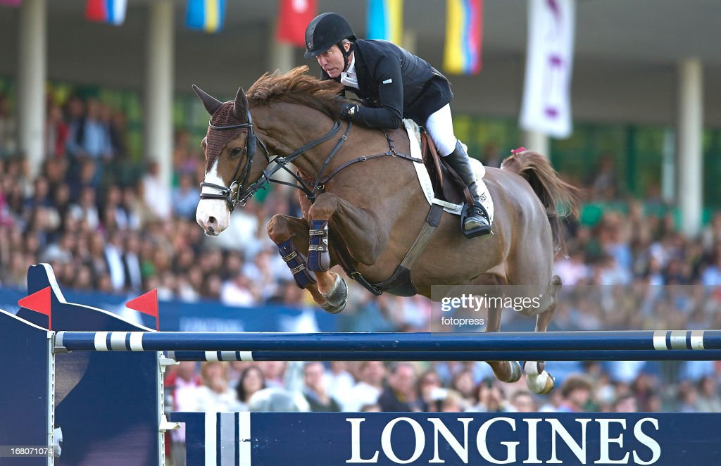 <a gi-track='captionPersonalityLinkClicked' href=/galleries/search?phrase=Michael+Whitaker&family=editorial&specificpeople=607520 ng-click='$event.stopPropagation()'>Michael Whitaker</a> of Great Britain rides Viking during the CSI 5 de Madrid / Longines Global Champions Tour 2013 at the Club de Campo Villa de Madrid on May 04, 2013 in Madrid, Spain.