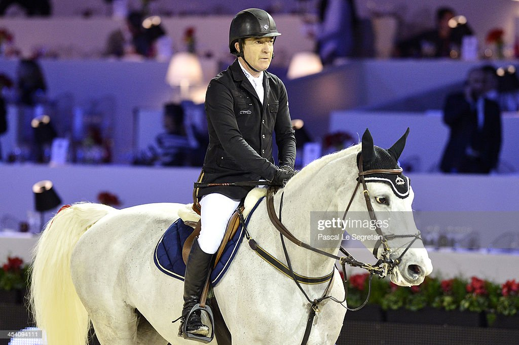 <a gi-track='captionPersonalityLinkClicked' href=/galleries/search?phrase=Michael+Whitaker&family=editorial&specificpeople=607520 ng-click='$event.stopPropagation()'>Michael Whitaker</a> rides Elie van de Kolmen during the 'Prix salon du Cheval Ceneca' at the Gucci Paris Masters 2013 on December 7, 2013 in Paris, France.