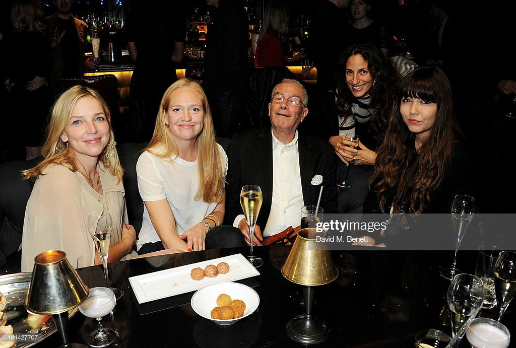 <a gi-track='captionPersonalityLinkClicked' href=/galleries/search?phrase=Michael+White+-+Producer&family=editorial&specificpeople=6514458 ng-click='$event.stopPropagation()'>Michael White</a> (C) and guests attend a post-screening party for 'The Last Impresario' during the 57th BFI London Film Festival at The Arts Club on October 13, 2013 in London, England.