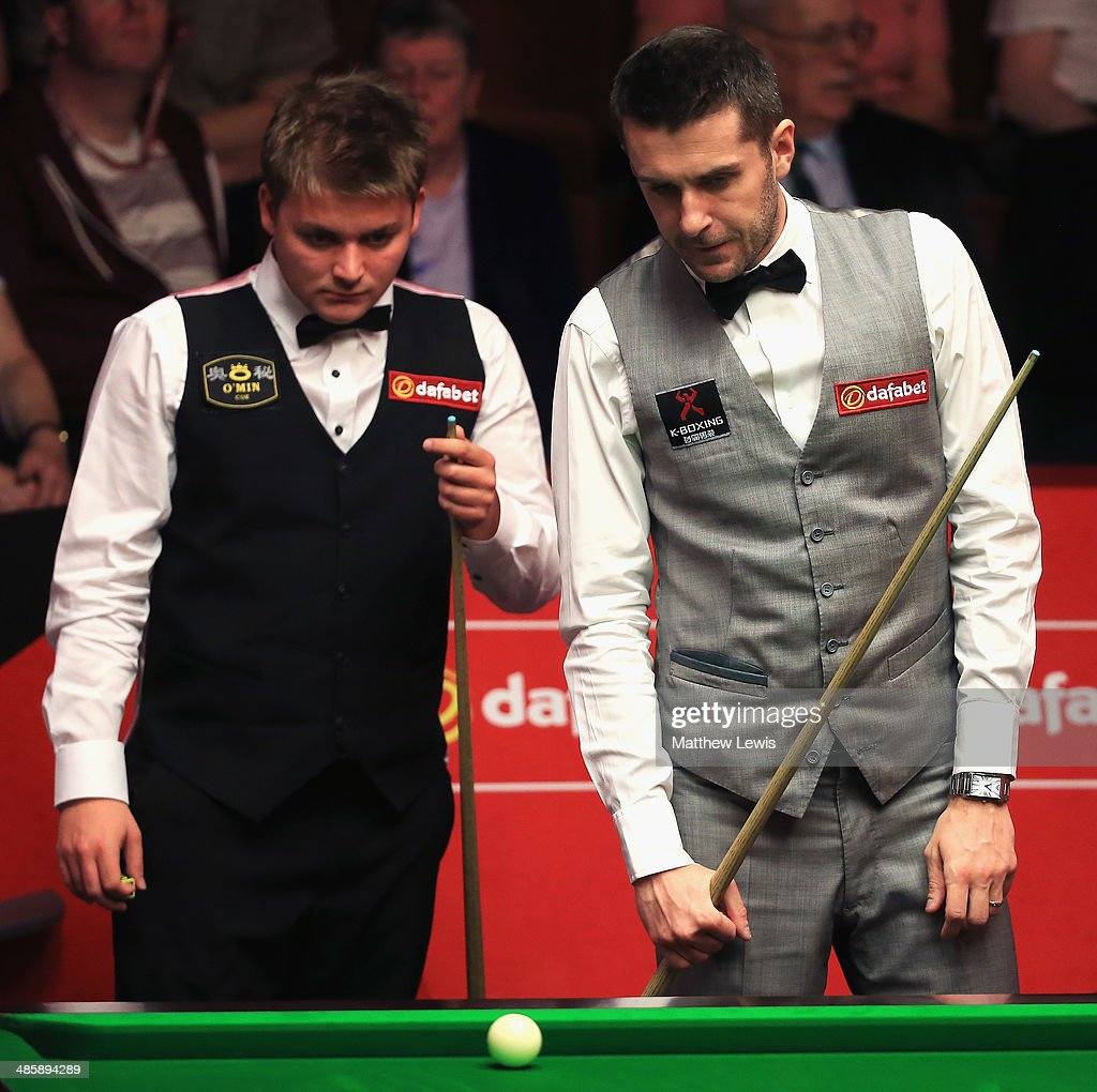 <a gi-track='captionPersonalityLinkClicked' href=/galleries/search?phrase=Michael+White+-+Snooker+Player&family=editorial&specificpeople=12541753 ng-click='$event.stopPropagation()'>Michael White</a> of Wales and <a gi-track='captionPersonalityLinkClicked' href=/galleries/search?phrase=Mark+Selby&family=editorial&specificpeople=676444 ng-click='$event.stopPropagation()'>Mark Selby</a> of England look on during day four of the The Dafabet World Snooker Championship at Crucible Theatre on April 21, 2014 in Sheffield, England.