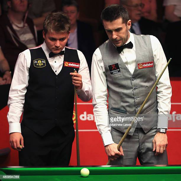Michael White of Wales and Mark Selby of England look on during day four of the The Dafabet World Snooker Championship at Crucible Theatre on April...