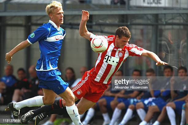 Michael Wiemann of Rostock battles for the ball with Deniz Mujic of Muenchen during the Third League match between FC Bayern Muenchen II and FC Hansa...