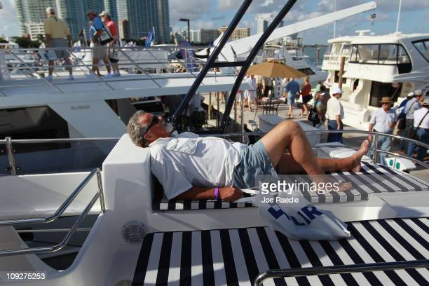 Michael Williams checks out a Cruiser Cats boat on display at The Miami International Boat Show and Strictly Sail show taking place at the Miami...