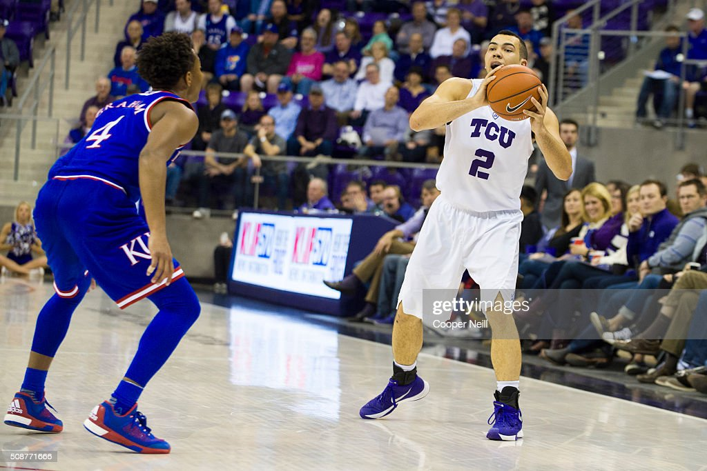 Michael Williams #2 of the TCU Horned Frogs brings the ball up court against Devonte' Graham #4 of the Kansas Jayhawks on February 6, 2016 at the Ed and Rae Schollmaier Arena in Fort Worth, Texas.