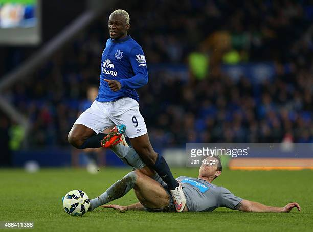 Michael Williamson of Newcastle United slides in to tackle Arouna Kone of Everton during the Barclays Premier League match between Everton and...