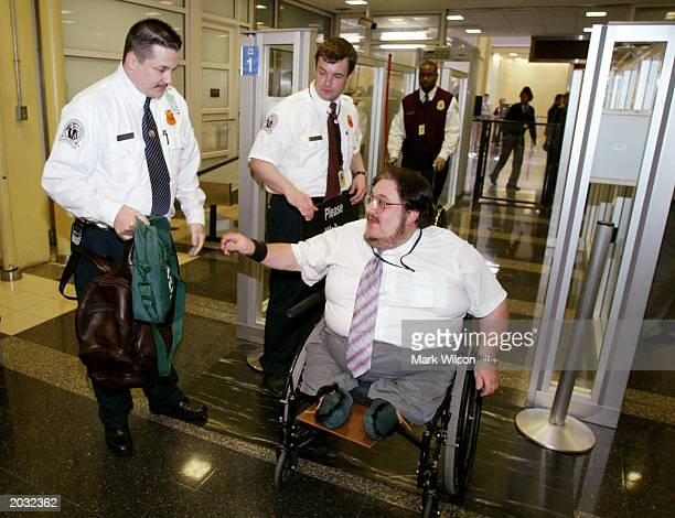 Michael Winter passes through an inspection by members of the Transportation Security Administration during a demonstration at Reagan National...