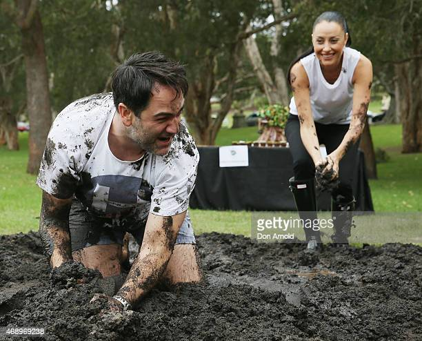 Michael Wipfli and Terri Biviano participate in a mud fight to raise awareness about the 'Mud Pie Project' to help raise funds to complete the Ian...