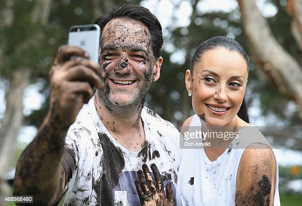 Michael Wipfli and Terri Biviano take a selfie after participating in a mud fight to raise awareness about the 'Mud Pie Project' to help raise funds...