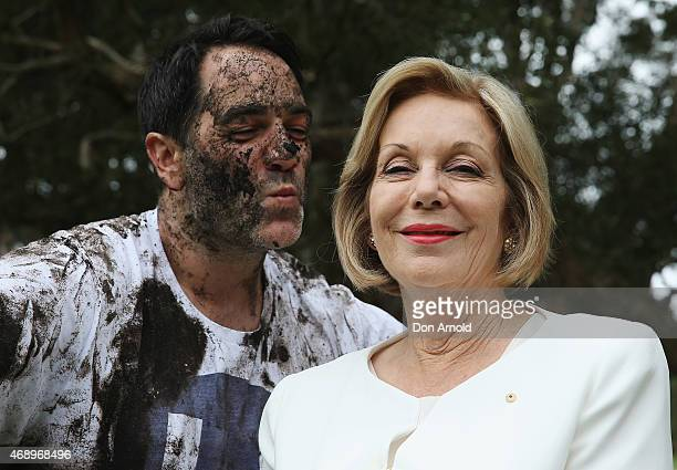 Michael Wipfli kisses Ita Buttrose after participating in a mud fight to raise awareness about the 'Mud Pie Project' to help raise funds to complete...