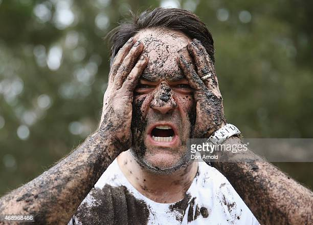Michael Wipfli poses after participating in a mud fight to raise awareness about the 'Mud Pie Project' to help raise funds to complete the Ian Potter...