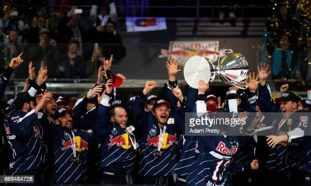 Michael Wolf of Muenchen and his team mates celebrate winning the DEL PlayOffs Final Match 5 between EHC Muenchen and the Grizzlys Wolfsburg at...
