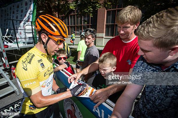 Michael Woods of the Optum Pro Cycling Team signs autographs for fans during stage 6 of the Tour of Utah on August 8 2015 in Salt Lake City Utah