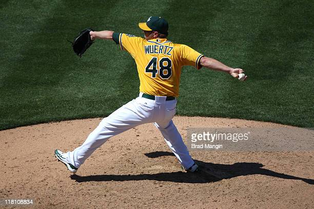 Michael Wuertz of the Oakland Athletics pitches against the Arizona Diamondbacks during the game at the OaklandAlameda County Coliseum on July 3 2011...