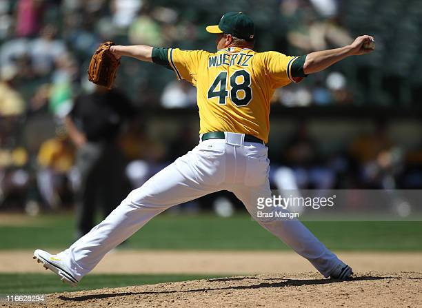Michael Wuertz of the Oakland Athletics pitches against the Kansas City Royals during the game at the OaklandAlameda County Coliseum on Thursday June...