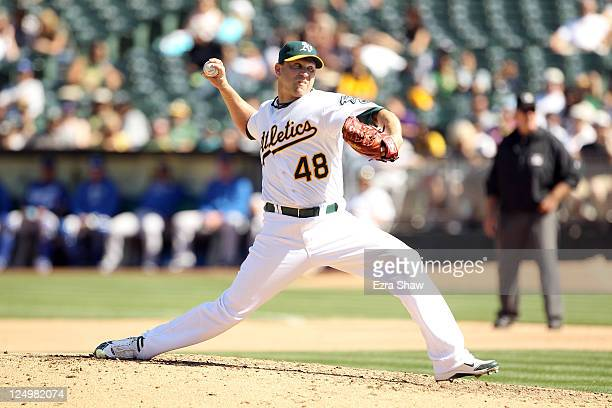 Michael Wuertz of the Oakland Athletics pitches against the Kansas City Royals at Oco Coliseum on September 5 2011 in Oakland California