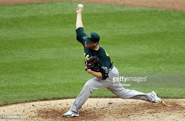 Michael Wuertz of the Oakland Athletics pitches against the New York Mets at Citi Field on June 23 2011 in the Flushing neighborhood of the Queens...