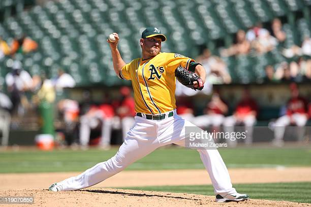 Michael Wuertz of the Oakland Athletics pitches during the game against the Arizona Diamondbacks at the OaklandAlameda County Coliseum on July 3 2011...