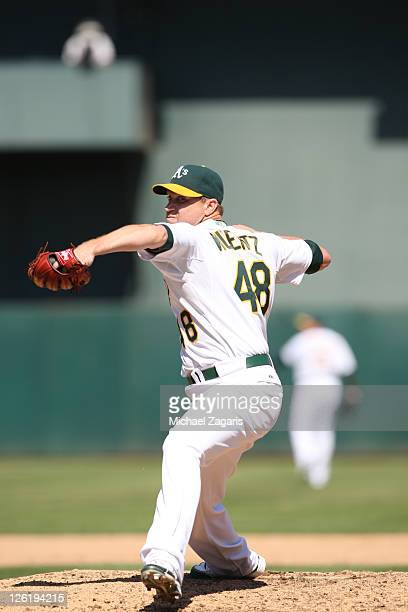 Michael Wuertz of the Oakland Athletics pitches during the game against the Kansas City Royals at the OaklandAlameda County Coliseum on September 5...