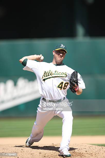 Michael Wuertz of the Oakland Athletics pitching during the game against the Cleveland Indians at the OaklandAlameda County Coliseum on May 5 2011 in...