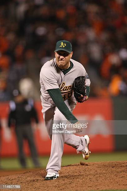 Michael Wuertz of the Oakland Athletics pitching during the game against the San Francisco Giants at ATT Park on May 20 2011 in San Francisco...