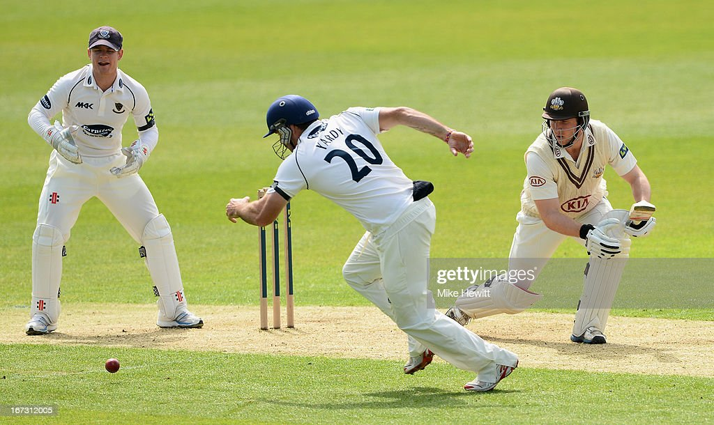 <a gi-track='captionPersonalityLinkClicked' href=/galleries/search?phrase=Michael+Yardy&family=editorial&specificpeople=2462981 ng-click='$event.stopPropagation()'>Michael Yardy</a> of Sussex sets off after a shot from Gary Wilson of Surrey as wicketkeeper Ben Brown looks on during day one of the LV County Championship Division One match between Surrey and Sussex at The Kia Oval on April 24, 2013 in London, England.