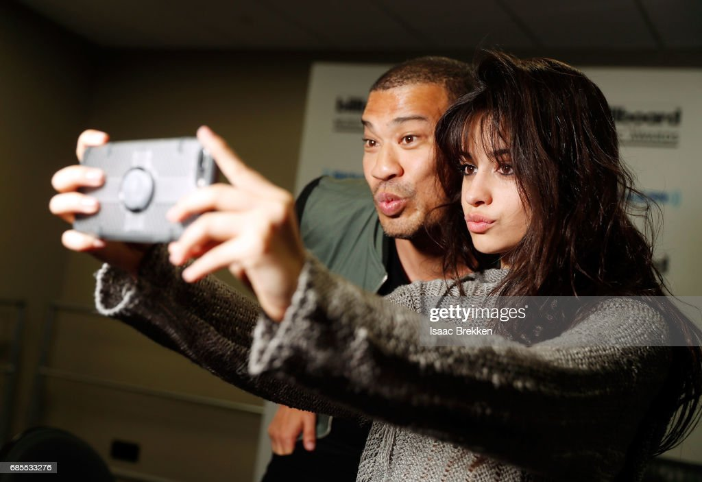 Michael Yo (L) and Camila Cabello take a selfie during SiriusXM's 'Hits 1 in Hollywood' broadcast on SiriusXM's SiriusXM Hits 1 channel leading up to the Billboard Music Awards at T-Mobile Arena on May 19, 2017 in Las Vegas, Nevada.