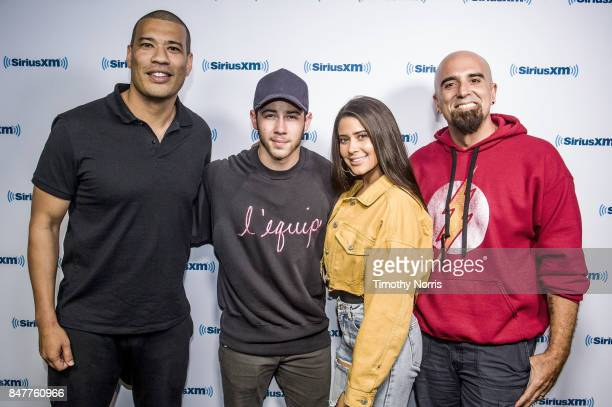 Michael Yo Nick Jonas Symon and Tony Fly attend at SiriusXM Studios on September 15 2017 in Los Angeles California