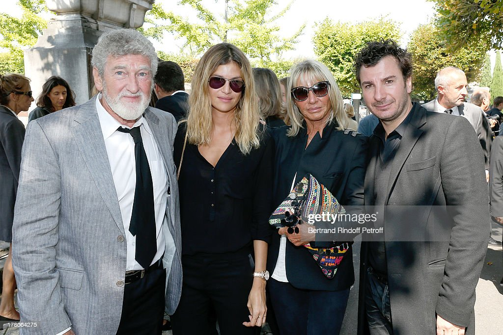 Michael Youn (R) and his wife Isabelle Funaro (2nd L) with Actor Patrick Prejean (L) and his wife Viviane (2nd R) attend President of FIFA protocol Doctor Pierre Huth Funeral in Nogent Sur Marne cemetery on August 30, 2013 in Nogent-sur-Marne, France.