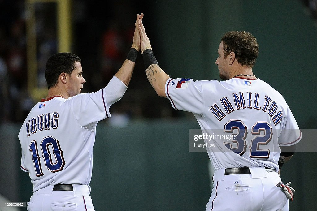 Michael Young and Josh Hamilton of the Texas Rangers celebrate a 92 lead at the end of the third inning of Game Six of the American League...