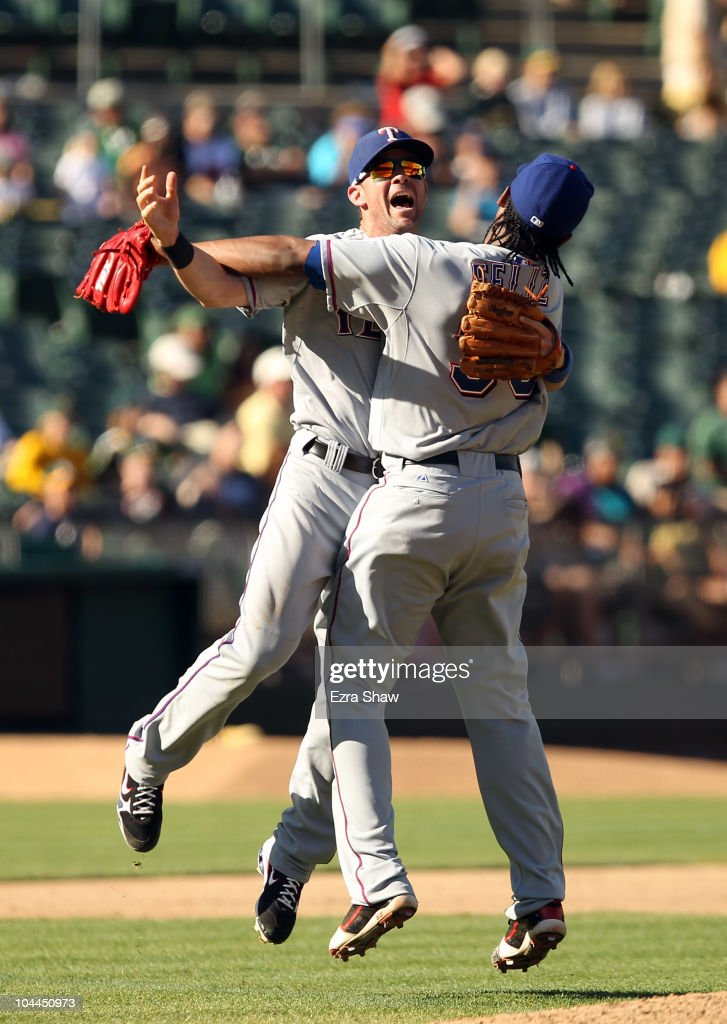 Michael Young and Neftali Feliz of the Texas Rangers celebrate after they beat the Oakland Athletics to clinch the American League West Title at the...