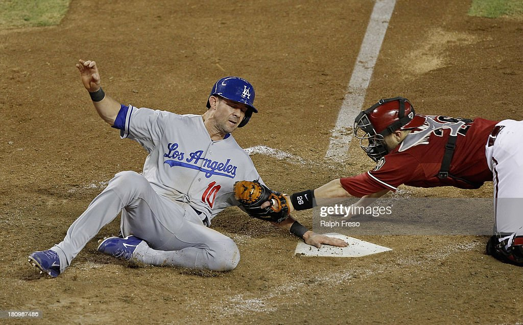 Michael Young of the Los Angeles Dodgers is called out on a tag by catcher Miguel Montero of the Arizona Diamondbacks during the sixth inning of a...