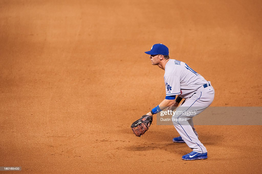 Michael Young of the Los Angeles Dodgers plays defense as he starts at first base in the third inning of a game against the Colorado Rockies at Coors...