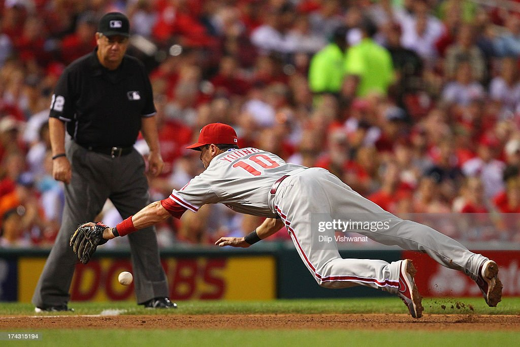 Michael Young #10 of the Philadelphia Phillies attempts to field a line drive against the St. Louis Cardinals in the fourth inning at Busch Stadium on July 23, 2013 in St. Louis, Missouri. The Cardinals beat the Phillies 4-1.