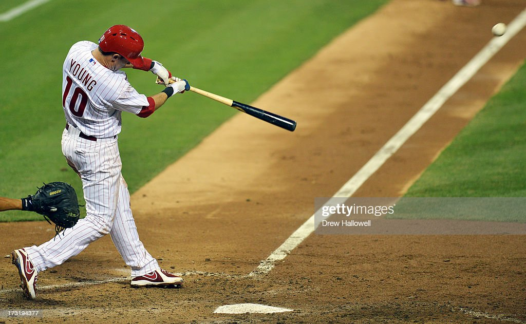 <a gi-track='captionPersonalityLinkClicked' href=/galleries/search?phrase=Michael+Young+-+Baseball+Player&family=editorial&specificpeople=203149 ng-click='$event.stopPropagation()'>Michael Young</a> #10 of the Philadelphia Phillies hits a two-run double in the sixth inning against the Washington Nationals at Citizens Bank Park on July 9, 2013 in Philadelphia, Pennsylvania. The Phillies won 4-2.