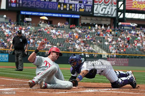 Michael Young of the Philadelphia Phillies is tagged out by Wilin Rosario of the Colorado Rockies on a close play at home plate on a double by Ryan...