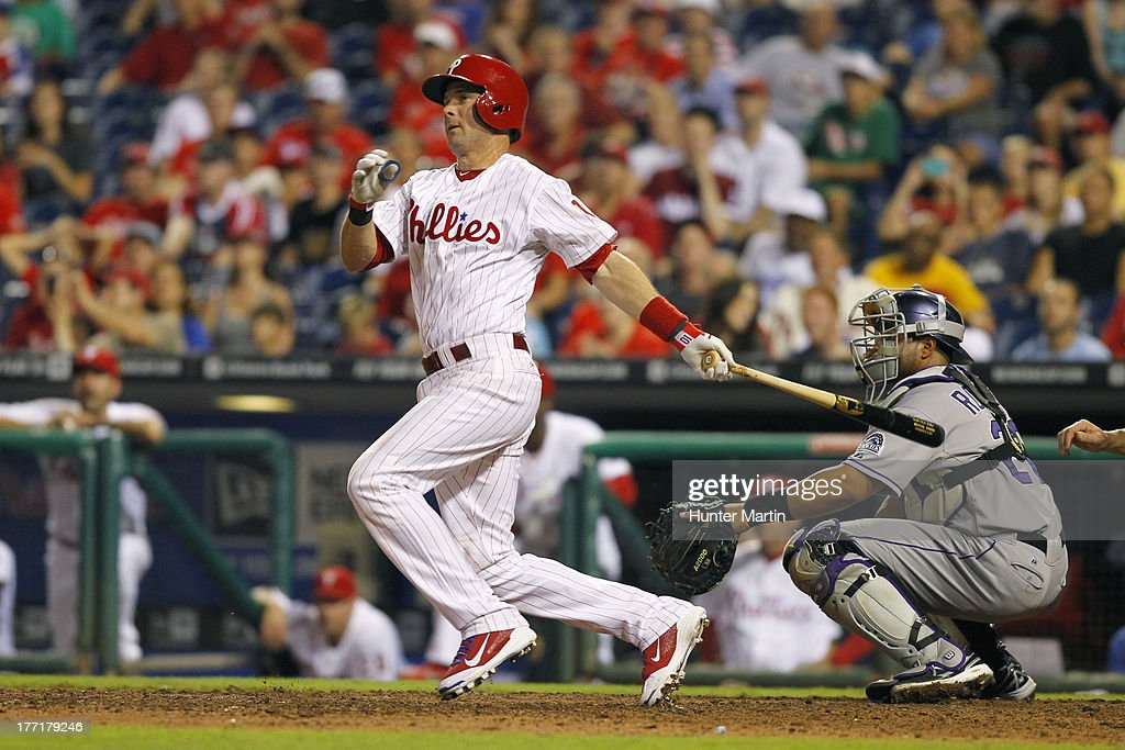 <a gi-track='captionPersonalityLinkClicked' href=/galleries/search?phrase=Michael+Young&family=editorial&specificpeople=203149 ng-click='$event.stopPropagation()'>Michael Young</a> #10 of the Philadelphia Phillies singles in the winning run in the ninth inning during a game against the Colorado Rockies at Citizens Bank Park on August 21, 2013 in Philadelphia, Pennsylvania. The Phillies won 4-3.