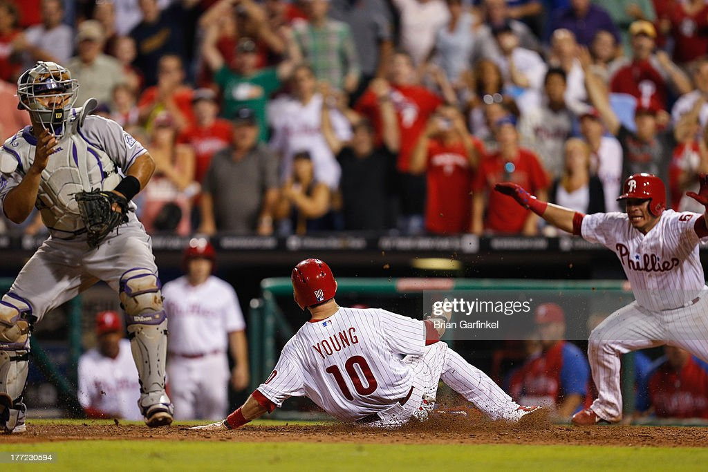 Michael Young of the Philadelphia Phillies slides home to score the game winning run in the bottom of the ninth inning of the game against the...