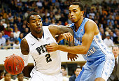 Michael Young of the Pittsburgh Panthers drives to the basket past Brice Johnson of the North Carolina Tarheels in the second half during the game at...