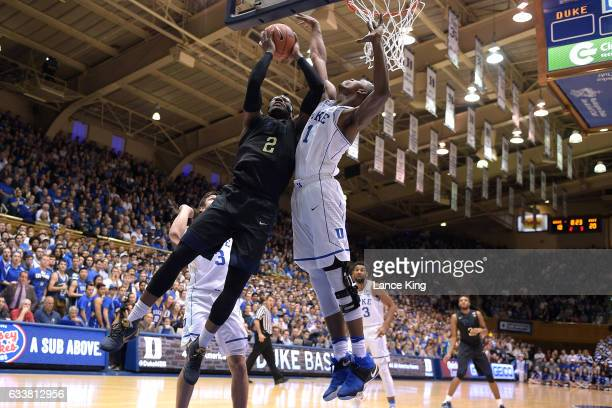 Michael Young of the Pittsburgh Panthers goes to the basket against Harry Giles of the Duke Blue Devils at Cameron Indoor Stadium on February 4 2017...