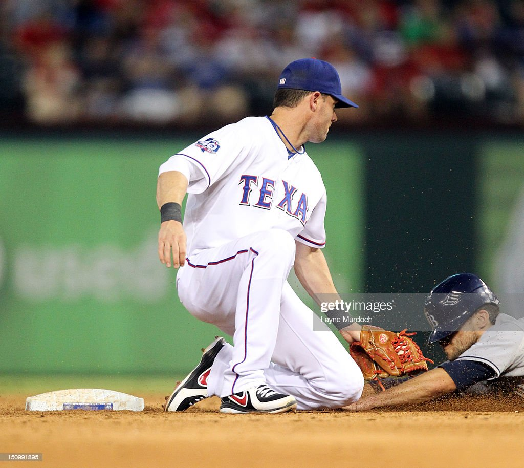 <a gi-track='captionPersonalityLinkClicked' href=/galleries/search?phrase=Michael+Young+-+Baseball+Player&family=editorial&specificpeople=203149 ng-click='$event.stopPropagation()'>Michael Young</a> #10 of the Texas Rangers appears to tag out <a gi-track='captionPersonalityLinkClicked' href=/galleries/search?phrase=Sam+Fuld&family=editorial&specificpeople=4505687 ng-click='$event.stopPropagation()'>Sam Fuld</a> #5 of the Tampa Bay Rays on August 29, 2012 but the runner was called safe at the Rangers Ballpark in Arlington in Arlington, Texas.