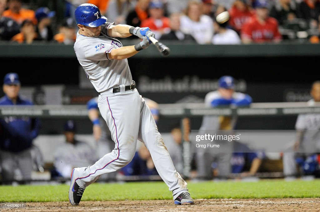 Michael Young of the Texas Rangers hits a home run in the ninth inning against the Baltimore Orioles at Oriole Park at Camden Yards on May 7 2012 in...