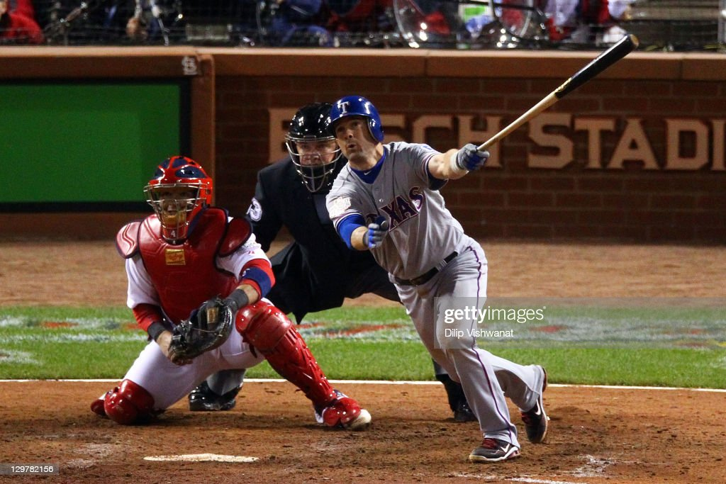 Michael Young of the Texas Rangers hits an RBI sacrifice fly ball to take a 32 lead in the ninth inning during Game Two of the MLB World Series...