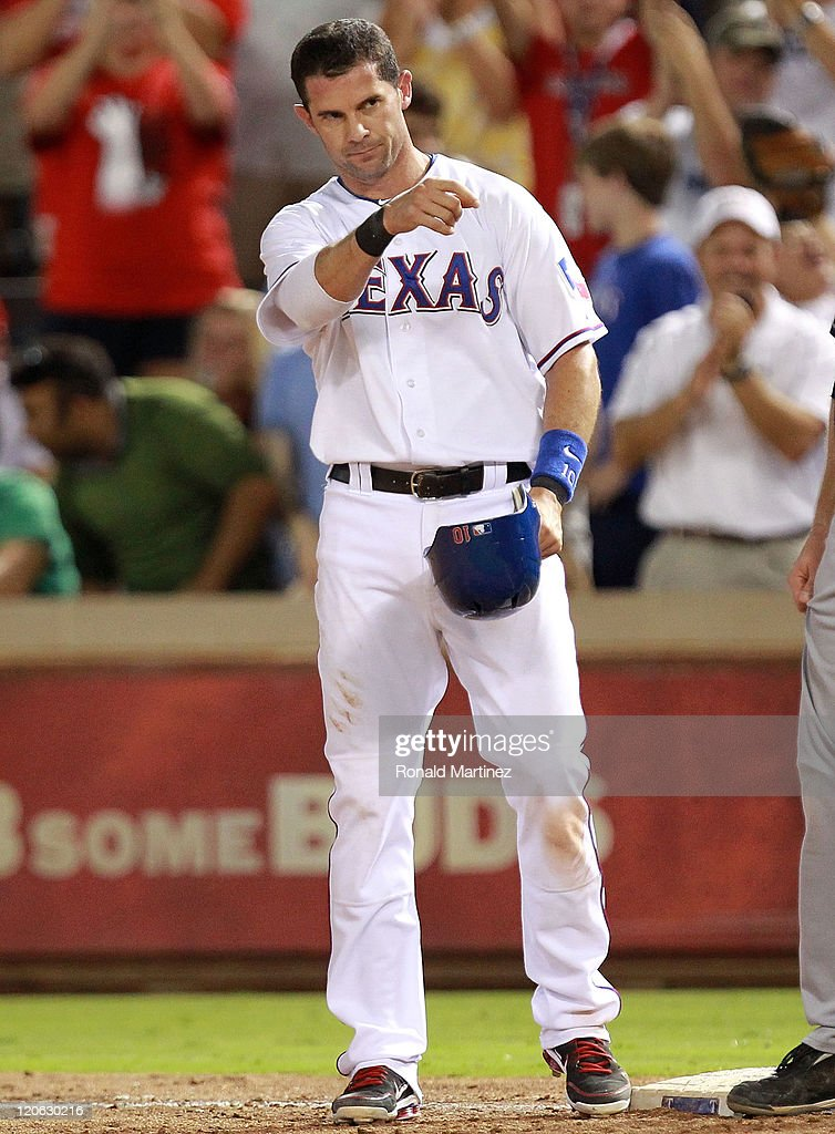 Michael Young of the Texas Rangers reacts after hitting a single for his 2000th career hit during play against the Cleveland Indians at Rangers...