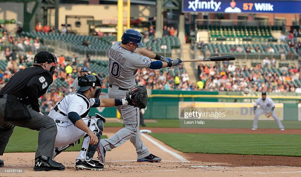 Michael Young of the Texas Rangers singles to left field scoring teammate Ian Kinsler in the first inning of the game against the Detroit Tigers at...