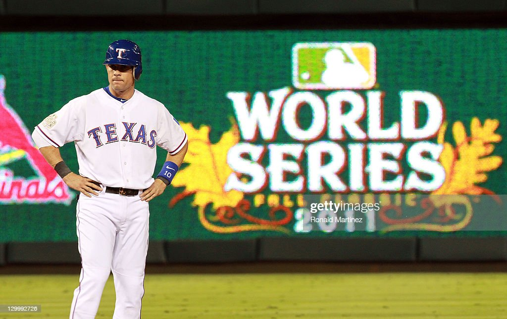 Michael Young of the Texas Rangers stands at second base after hitting an RBI double in the fifth inning during Game Three of the MLB World Series...