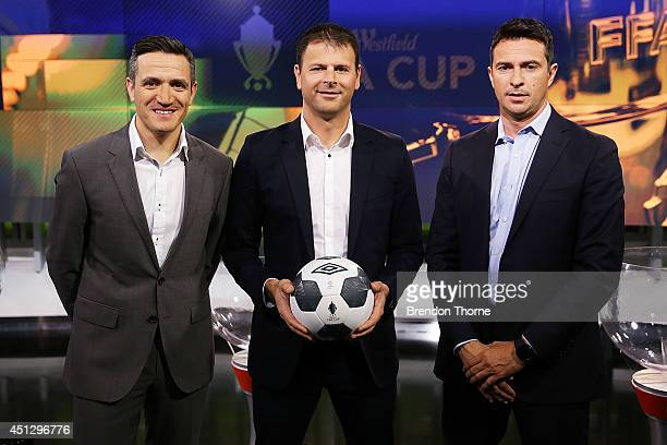 Michael Zappone and Former Socceroos Paul Okon and Mile Sterjovski pose following the official FFA Cup draw at Fox Sports Studios on June 27 2014 in...