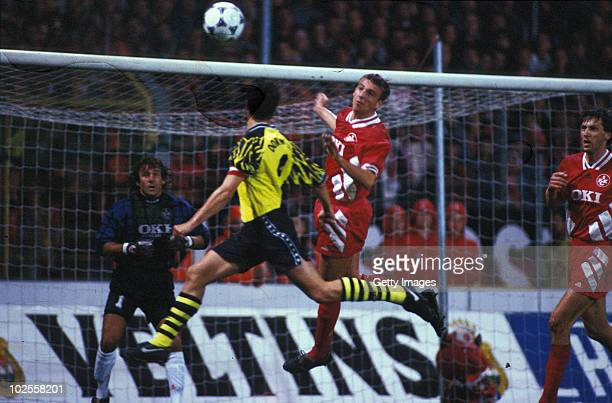 Michael Zorc of Dortmund goes up for a header during the DFB Cup second round match between 1 FC Kaiserslautern and Borussia Dortmund at Betzenberg...